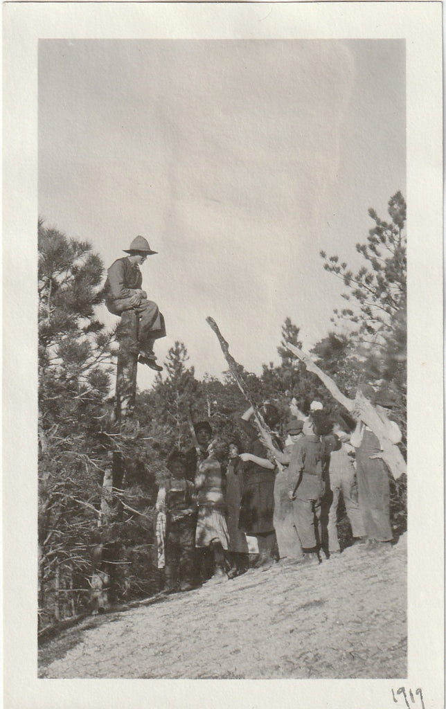 "6-Fingered Man Trapped in Tree by ""Angry Mob"" Photo, c. 1919"