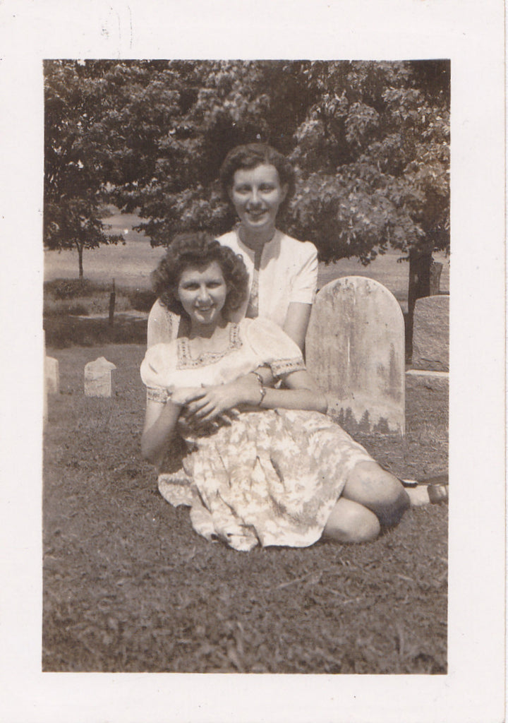 Women Posing in Cemetery Headstone