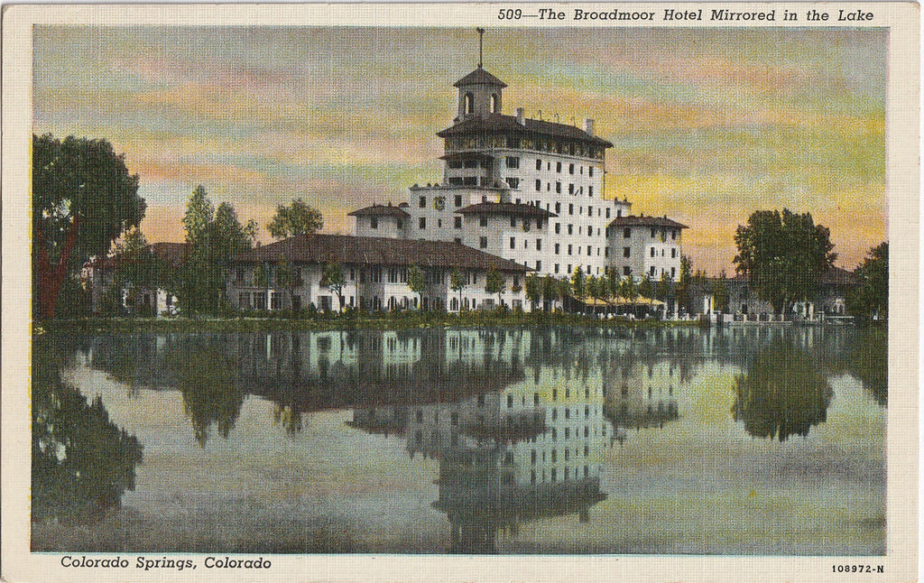 The Broadmoor Hotel Mirrored in the Lake Colorado Springs Postcard
