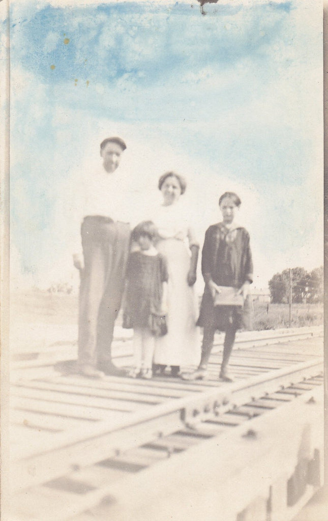 Right on Track- 1910s Antique Photograph- Family Posing on Train Tracks- Hand Tinted- Blue Sky- Real Photo Postcard- AZO RPPC