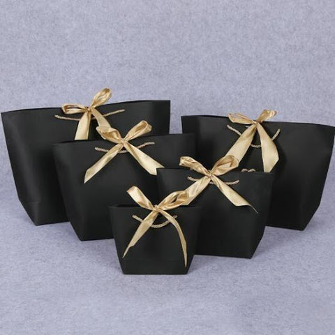 an image of black and gold luxury gift bags