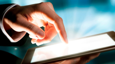 an image of a finger tapping a screen