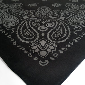 Black and gray paisley bandana shown at an angle