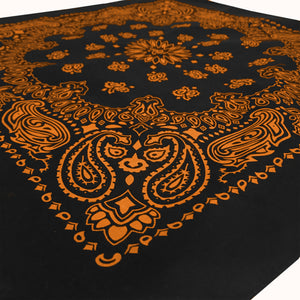 Black bandana with orange print angle view