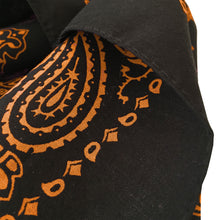 Load image into Gallery viewer, Black bandana with orange print hemmed edge closeup