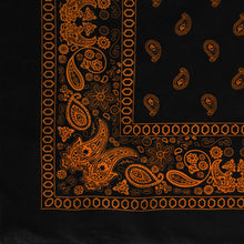 Load image into Gallery viewer, Black and orange paisley bandana with flower print, corner view