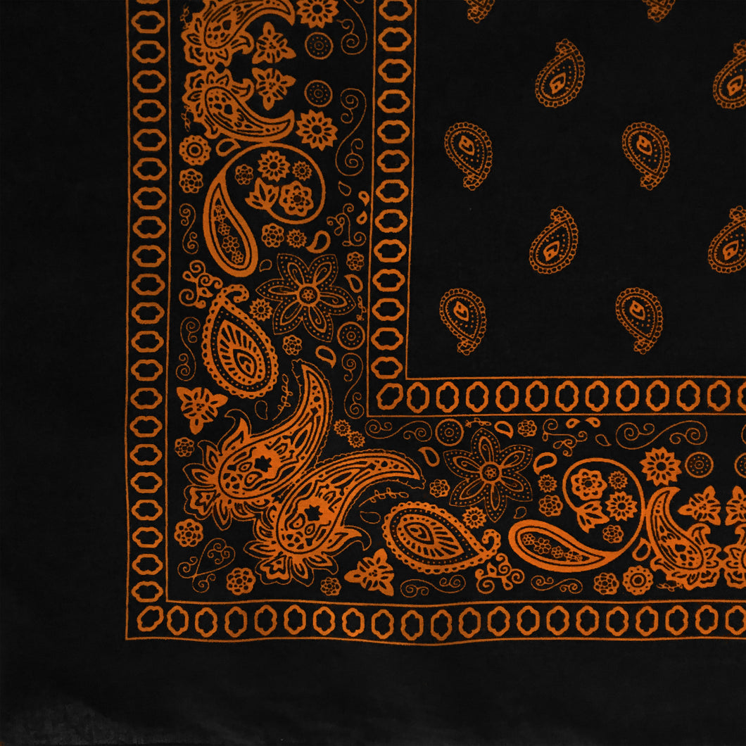 Black and orange paisley bandana with flower print, corner view