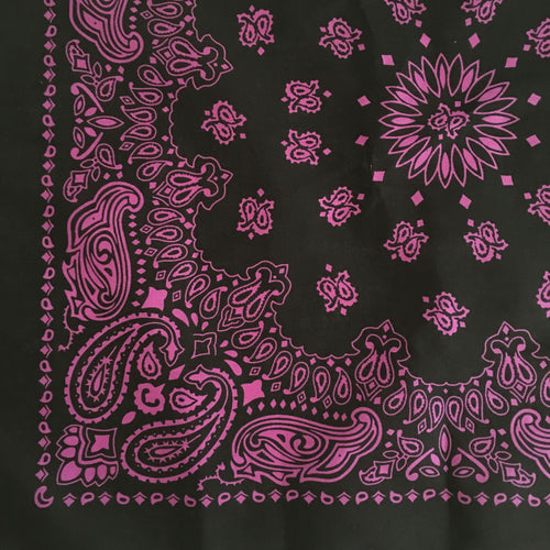 corner view of a black and pink cowboy bandana