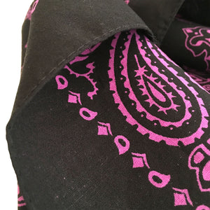 close up view of black and pink bandana hemmed edge