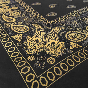 Black and yellow floral paisley bandana angle view