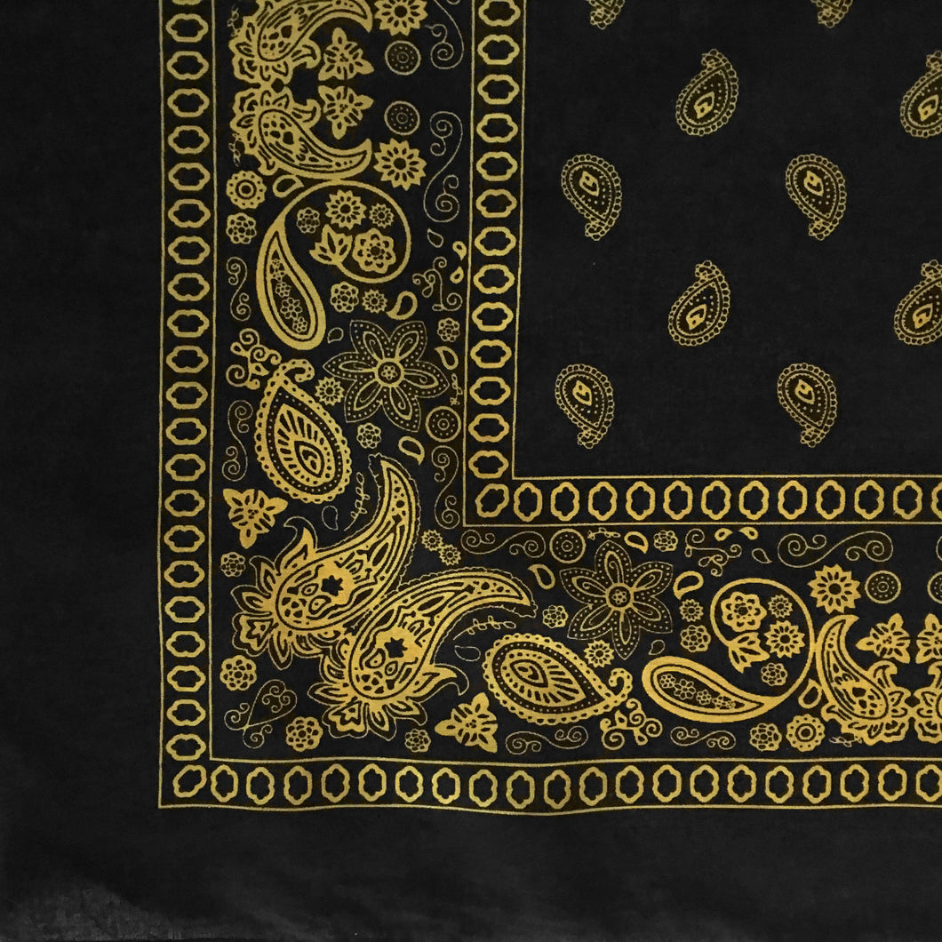Black and yellow bandana with paisley and floral print partial pattern