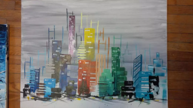 an abstract cityscape with multicoloured buildings against a grey background