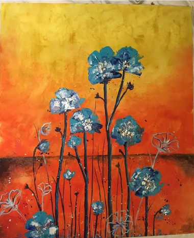 blue flowers are contrasted against an orange and yellow back ground