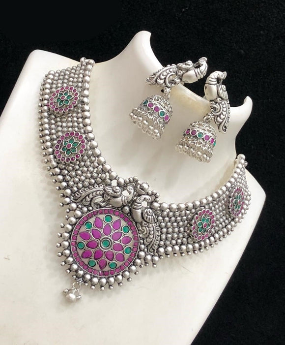 Silver Matte Finished Chandbali Necklace With Elegant Peacock Designed Earrings