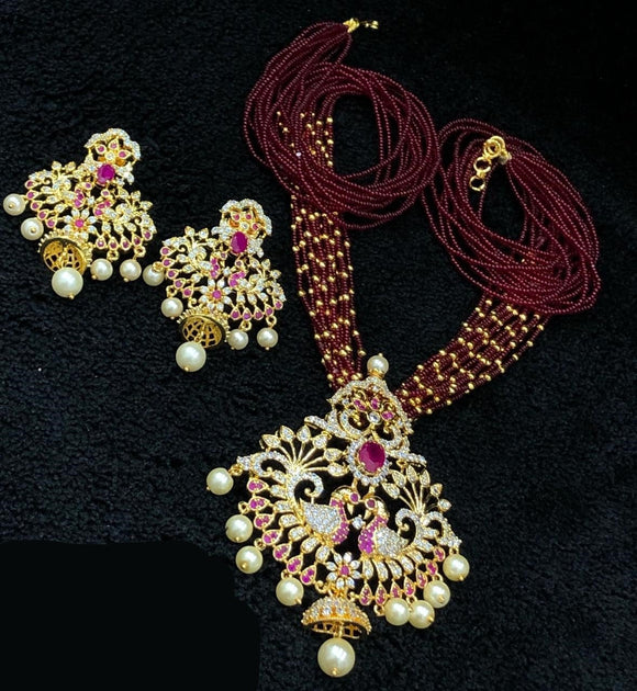 Gold Finished CZ Pendant Necklace With Maroon Beads Mala