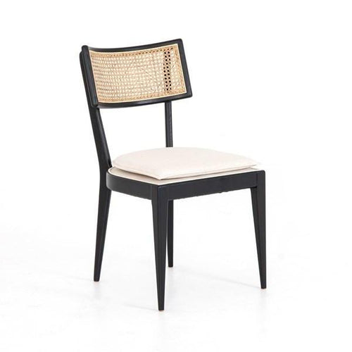cane dining chair with black frame and linen upholstery