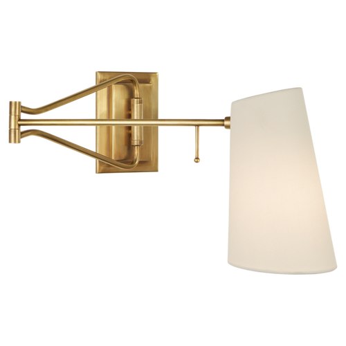 Brass and linen swing arm wall sconce