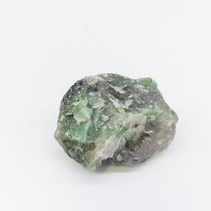 raw emerald  rough stone
