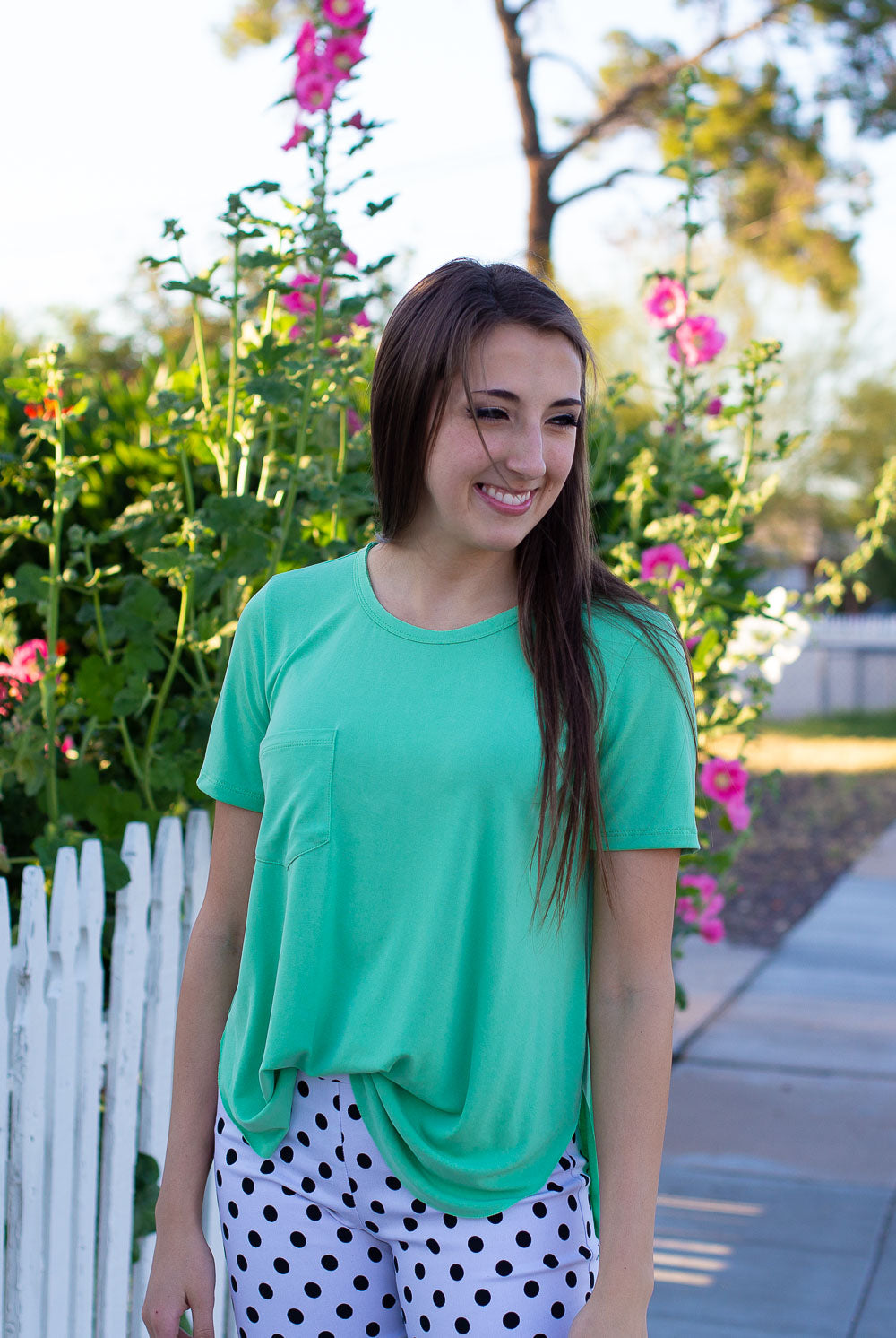 Mint green soft T-shirt with front pocket, side slits and high-low hemline