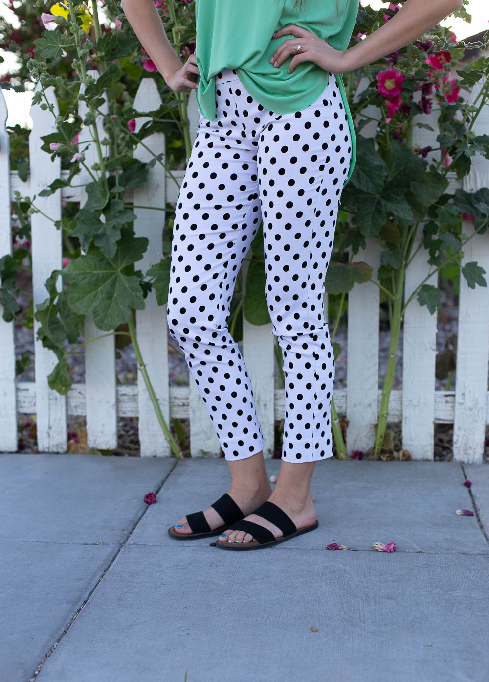 Stretch waist rayon slacks with black and white polka dots and cropped length