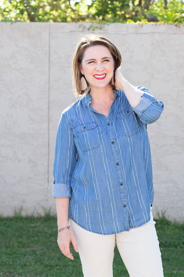 Long sleeved button down blue striped chambray top