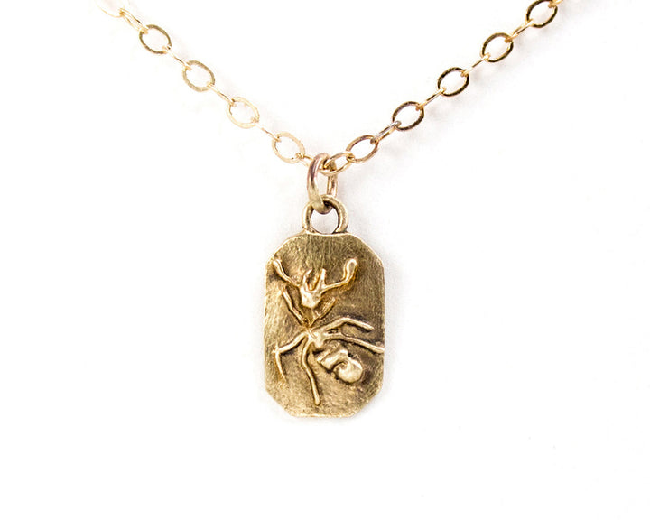 Gold bug necklace