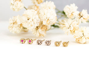 Small flower studs in 14k gold