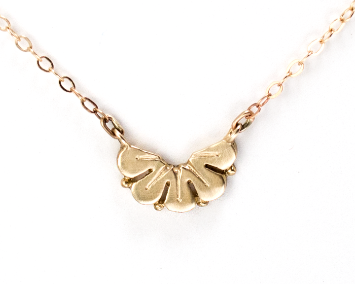 Nature-inspired gold petal necklace