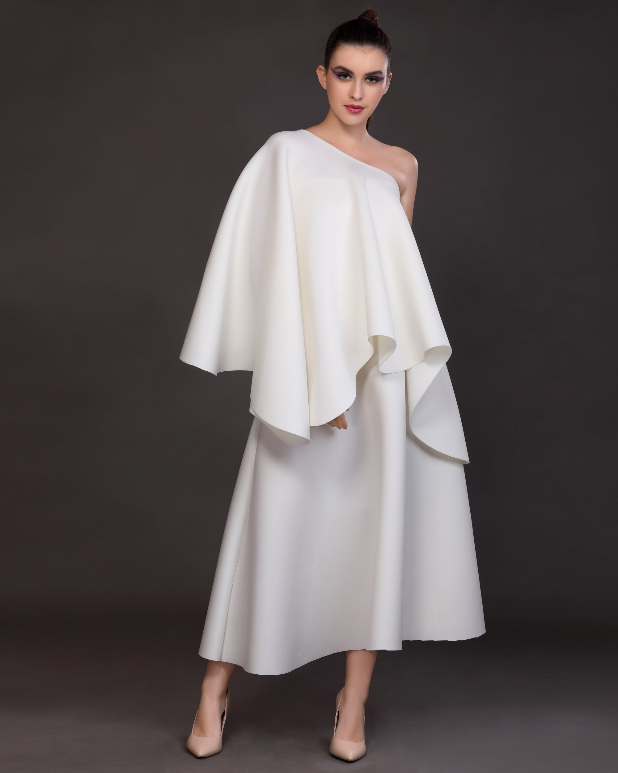 Essence- Voluminous high-low cape