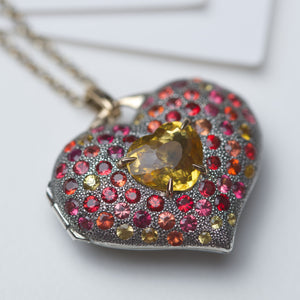 Heart locket in 18K gold, sterling silver with fancy sapphires and heliodor
