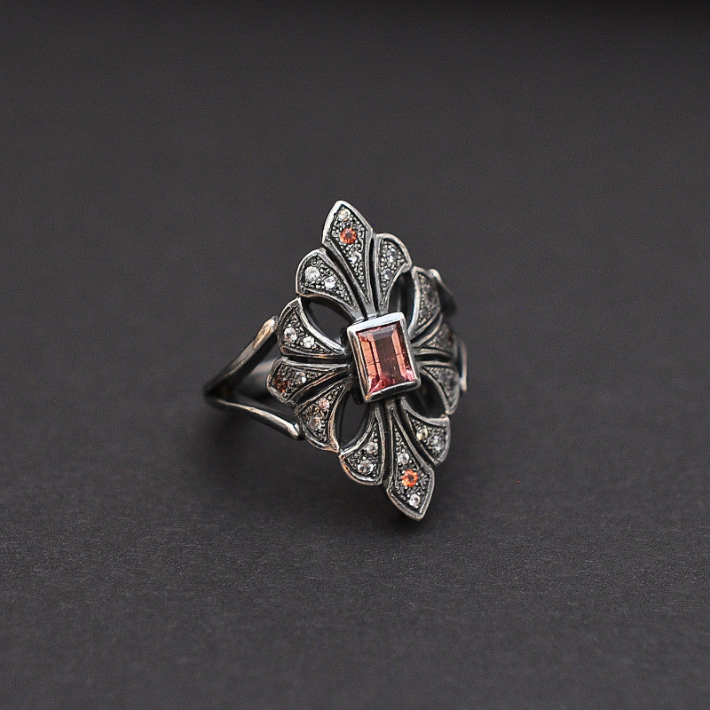 Ring in silver with imperial topaz, white sapphires and garnets by Ewa Z. Sleziona Jewellery