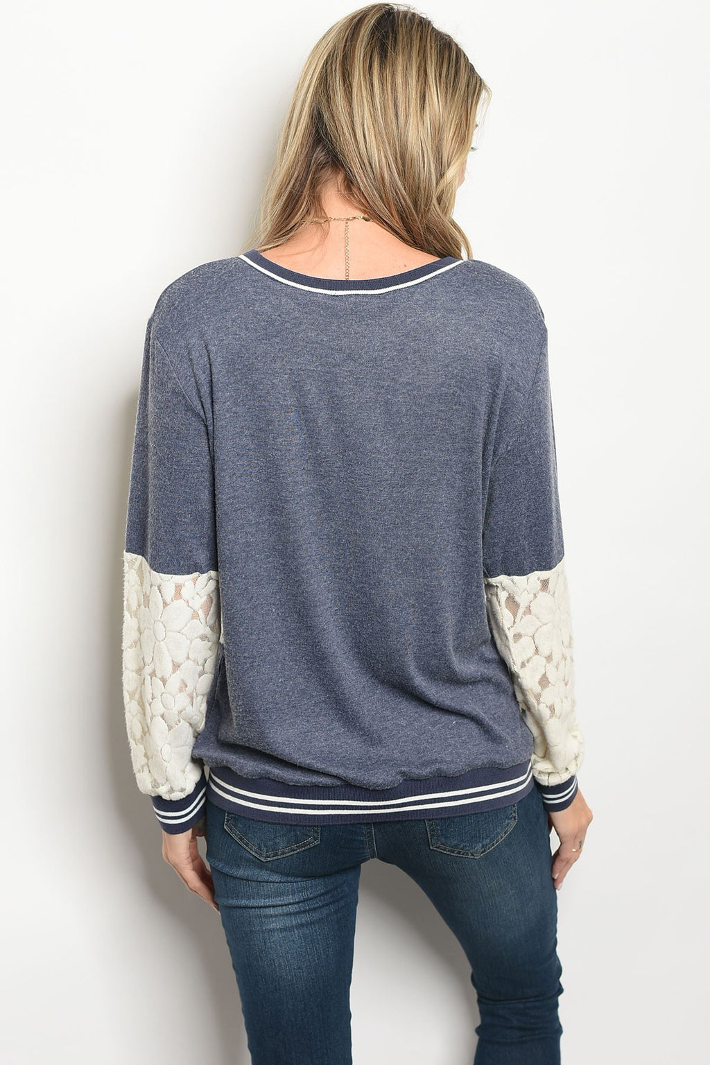 Ladies fashion long sleeve light weight knit top wit a crew neckline and lace details