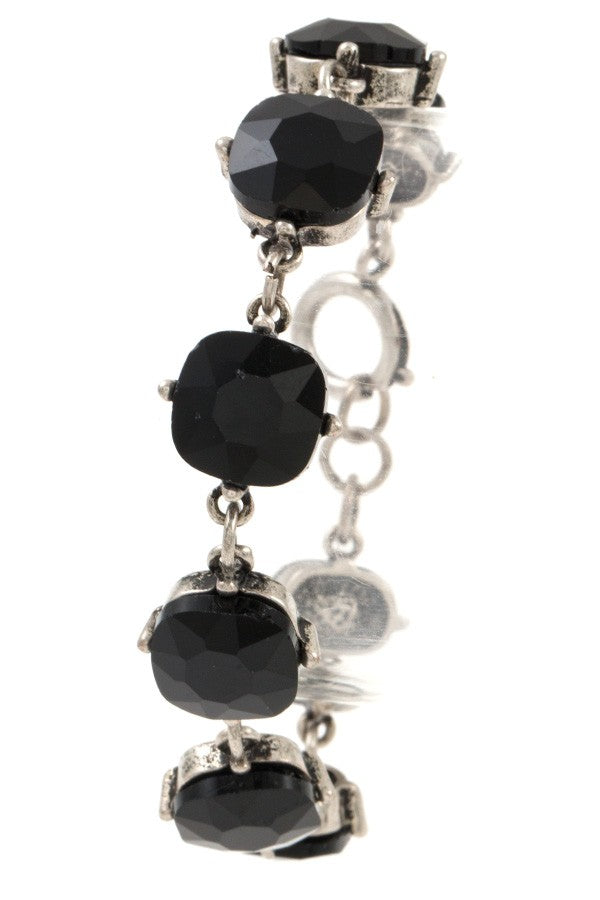 Faceted round framed gem bracelet