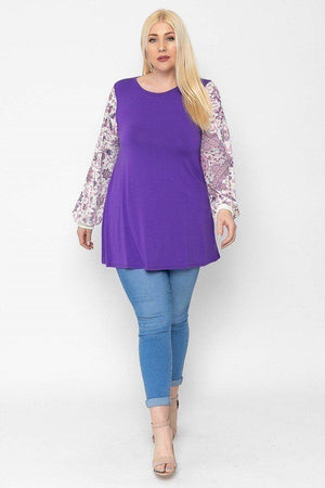 Floral Print, Contrasting Bubble Sleeves Tunic With A Round Neckline.