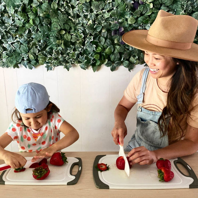 Elizabeth As A Full Time Cafeteria In Her Kitchen With The Help Of Her Kid Using The Zulay Kids Knife Set