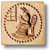 woman knitting by a window springerle emporium cookie mold