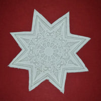paper cast from eight point ornamental star springerle mold