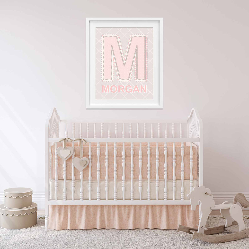 Nursery with framed name art above crib