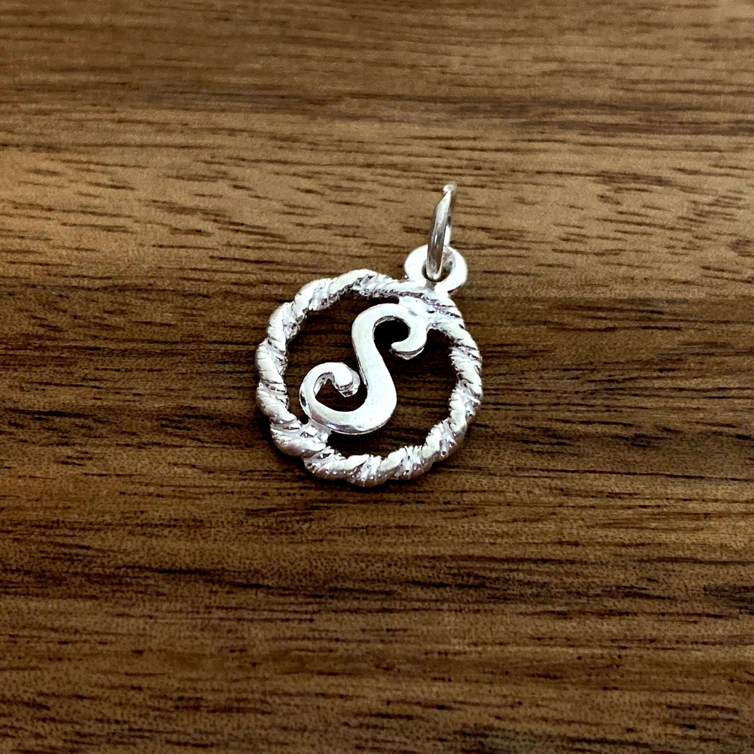 S initial charm