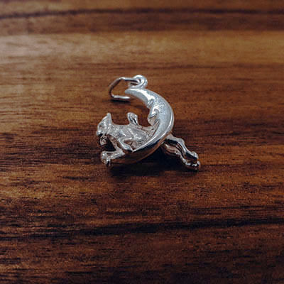 Cow jumping over the moon charm