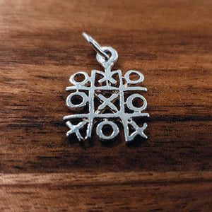 Silver Naughts and Crosses charm