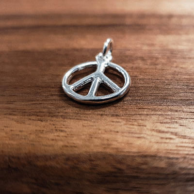 Silver rounded peace sign charm