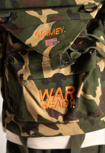 "Load image into Gallery viewer, ""PRISONER OF WAR"" CAMO BOOKBAG"