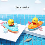 Load image into Gallery viewer, Baby Bath Toy Rowing Boat Duck Floating Water Wind-up Chain - ChildAngle
