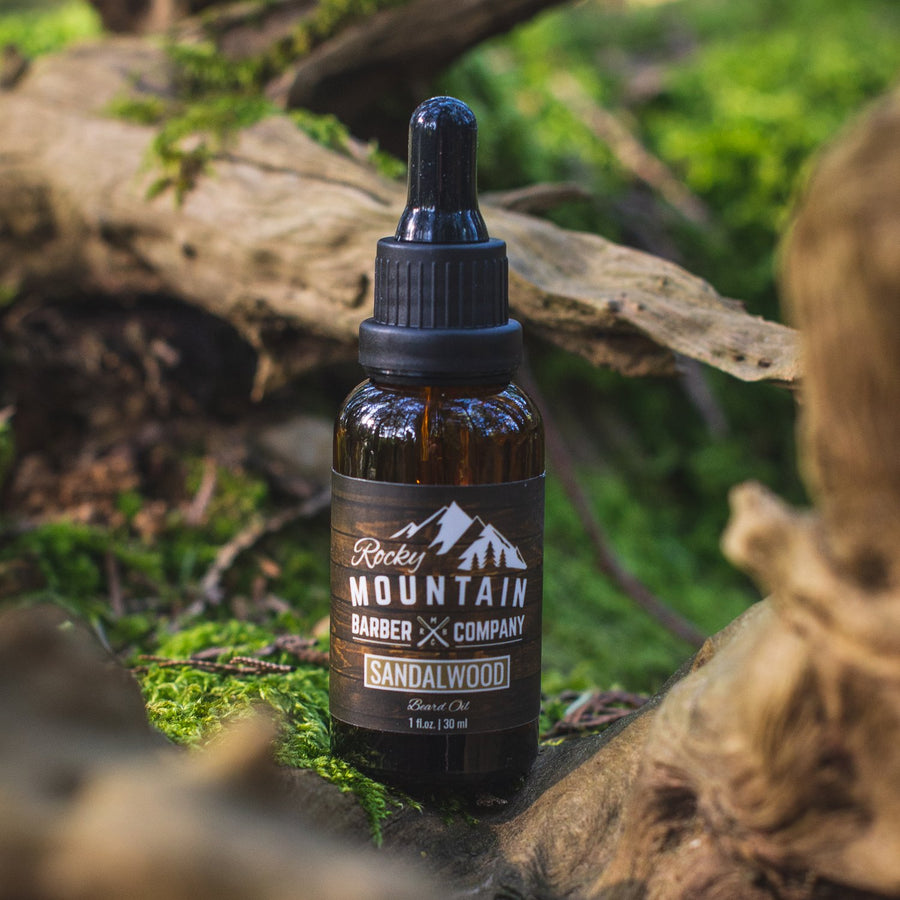 Rocky Mountain Barber Company Sandalwood Beard Oil Outdoors in Nature with Green Moss and Wood