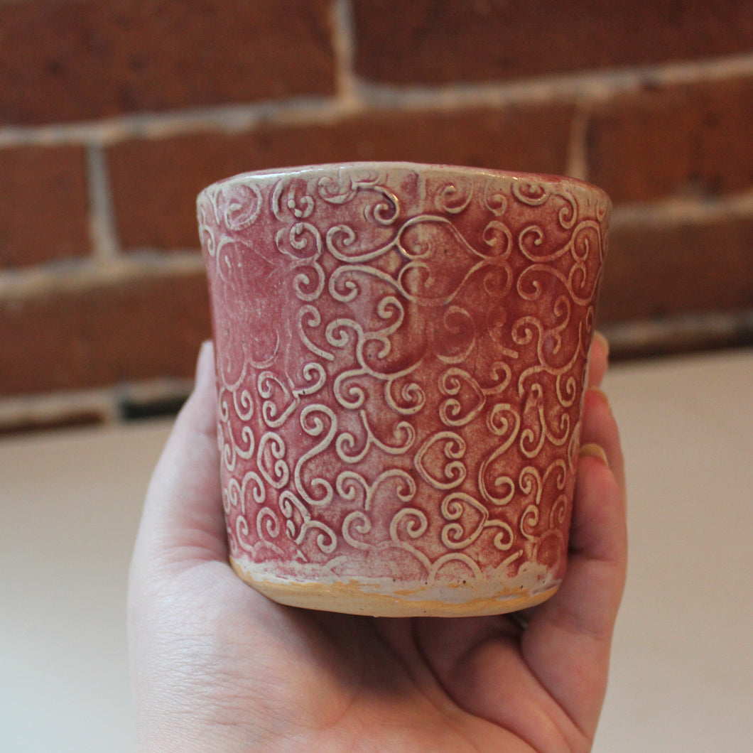 Pink handmade cup with fun heart scroll pattern