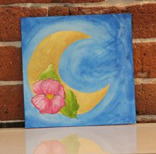 Load image into Gallery viewer, Original watercolor painting of pink flower adorned metallic moon with vibrant cyan blue sky