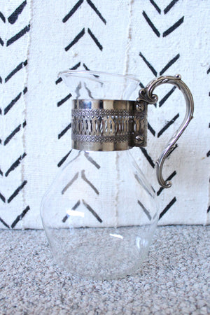 Glass and Silver Pitcher