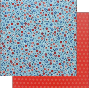 "Pebbles Collection Land That I Love Paper 12""x 12"" Patriotic Blooms- Double sided cardstock. One side is blue with small red, white and blue flowers with stems and leaves. The reverse side has tone-on-tone red dots."