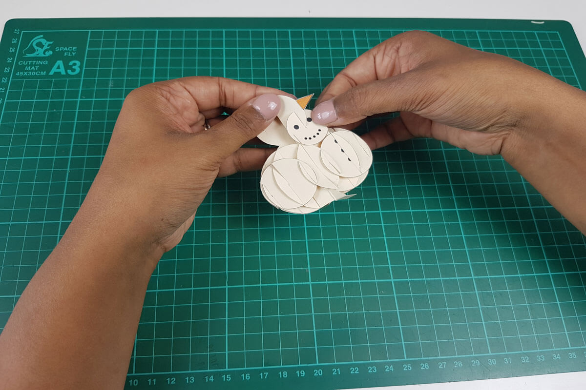 How To Make a 3D Christmas Pop Up Card - picture of putting the face of the snowman together